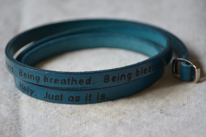 poetic leather wrist wrap, vibrant jewel tones, turquoise