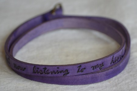poetic leather wrist wrap, vibrant jewel tones, lavender