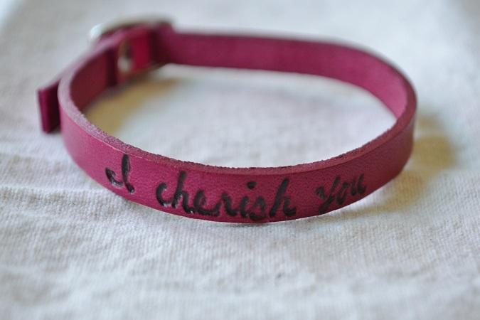 poetic leather wrist wrap, vibrant jewel tones, magenta
