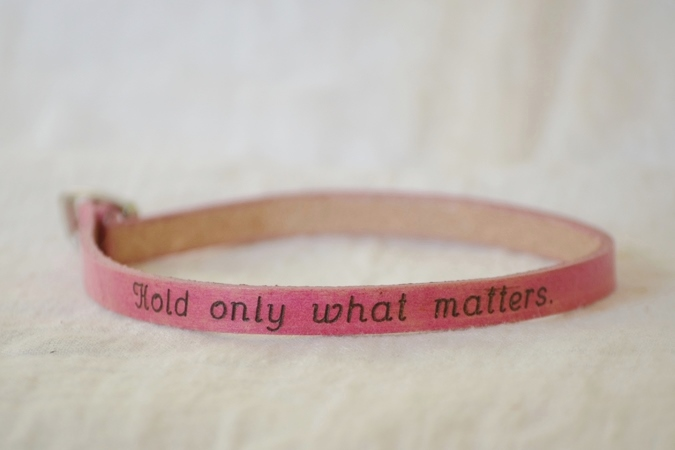 "poetic leather wrist wrap ""hold only what matters"""